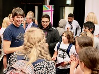 Professor Cox with young people