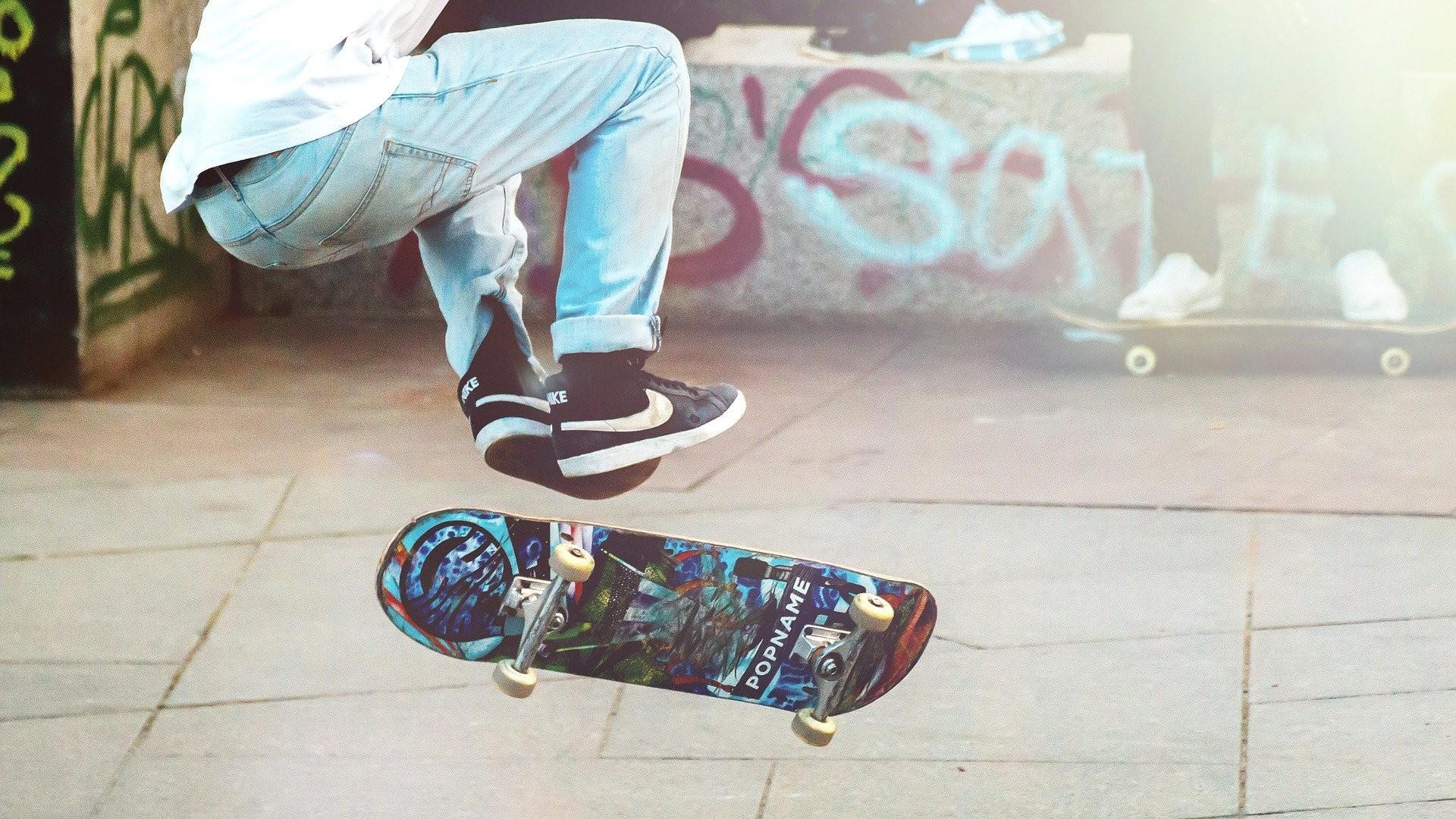 Skateboarder with graffiti background